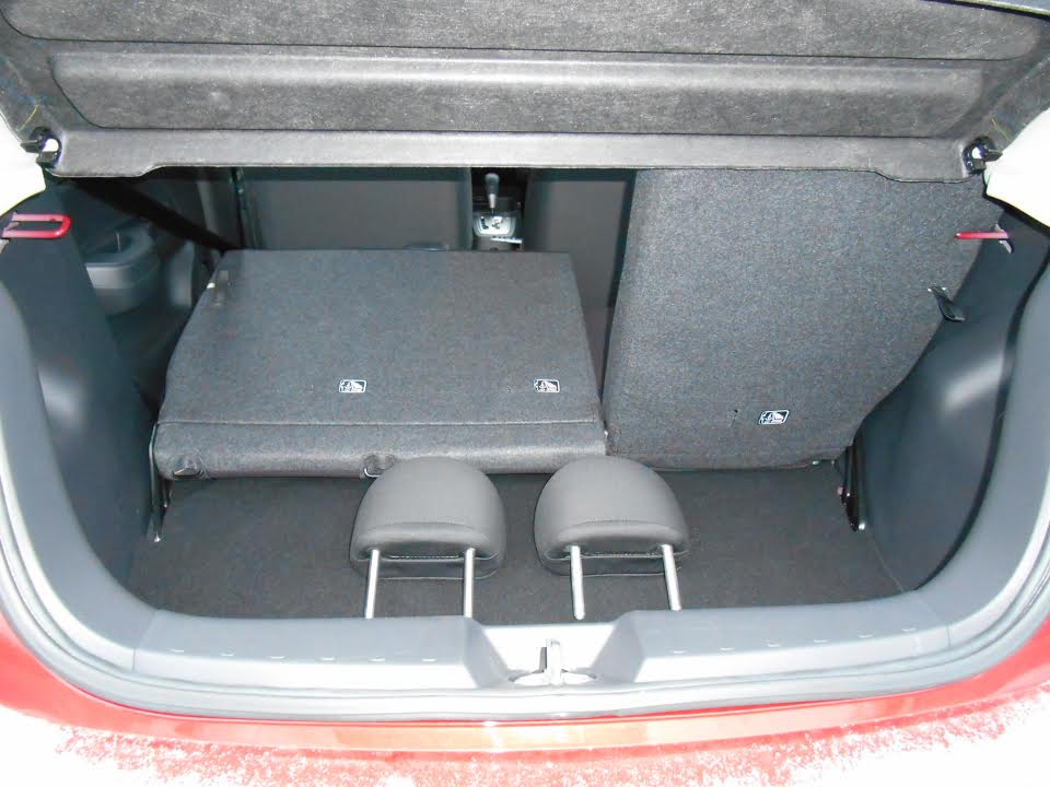 The split rear seat backs fold to create more cargo space (which is otherwise pretty limited), but the rear headrests must be removed first, and the seat backs rest three inches above the level of the cargo floor and don't lay flat.