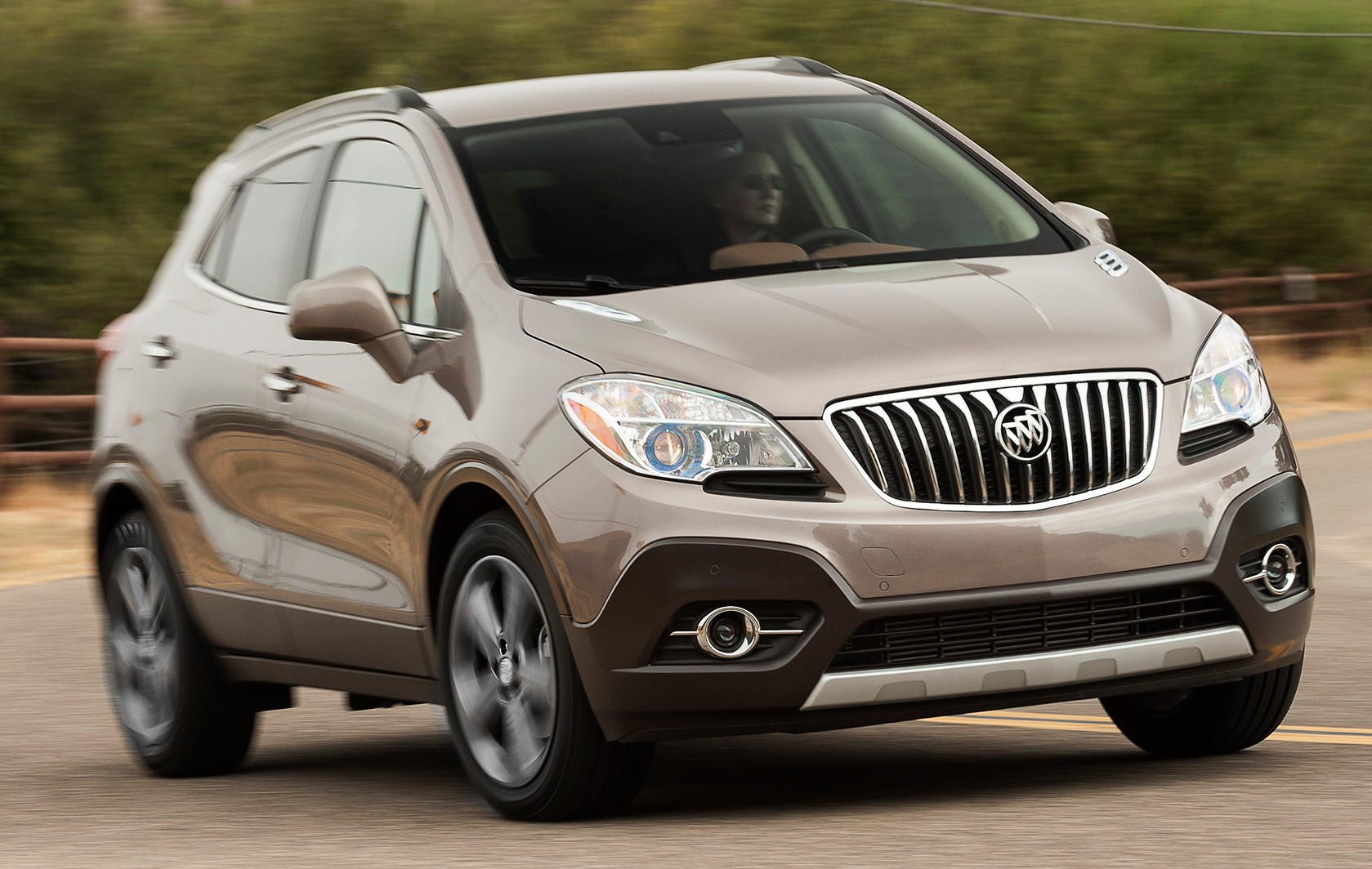 2014-Buick-Encore-Premium-FWD-three-quarters-in-motion-front-view