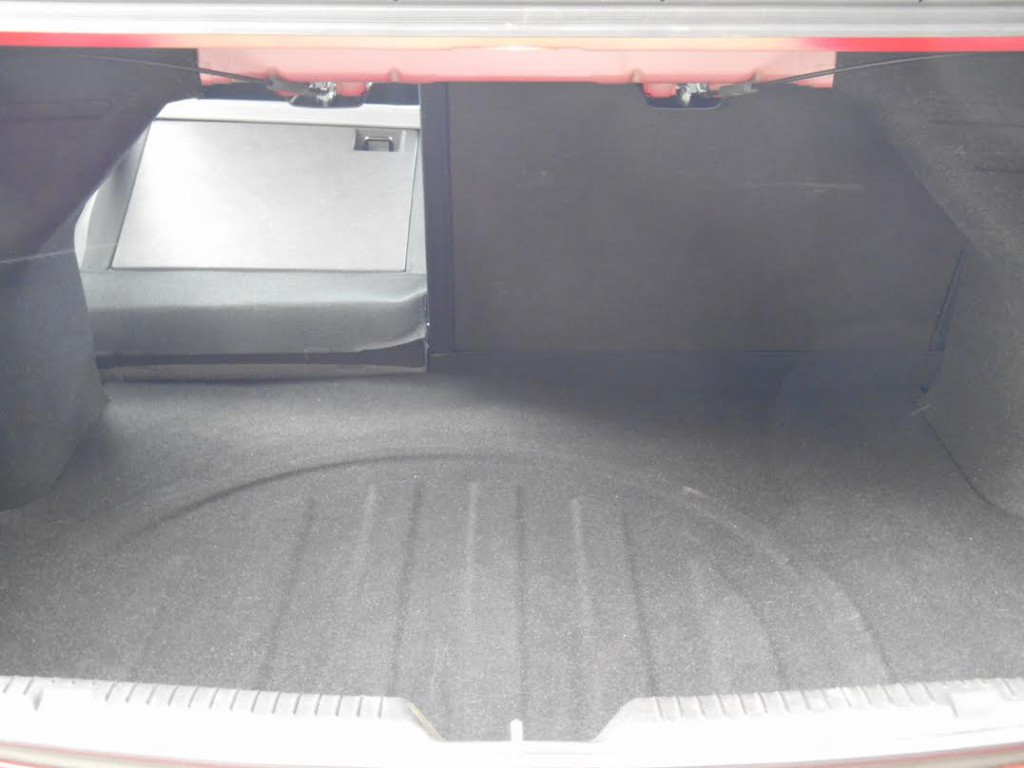 Elantra's rear seats don't fold flush into the cargo floor, but the trunk is usefully large as is the decklid opening.