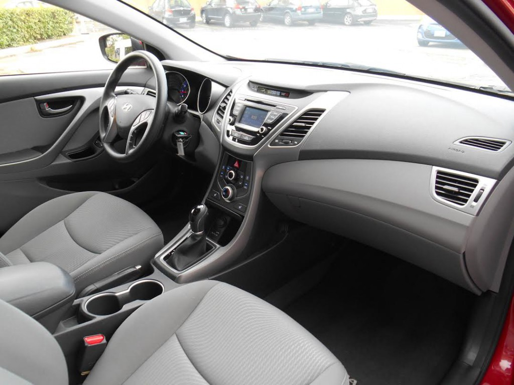 Elantra's cabin is roomy for the class, with plenty of head and leg room and shoulder room up front.