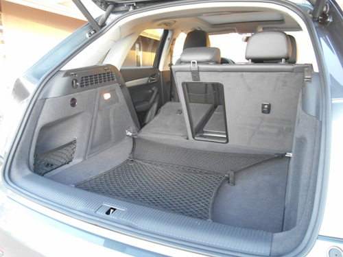 Q3's compact cargo area can be expanded by folding the rear seat backs, which lie flush with the cargo floor. There's also a separate ski pass-through and a cargo-floor net, both nice touches.