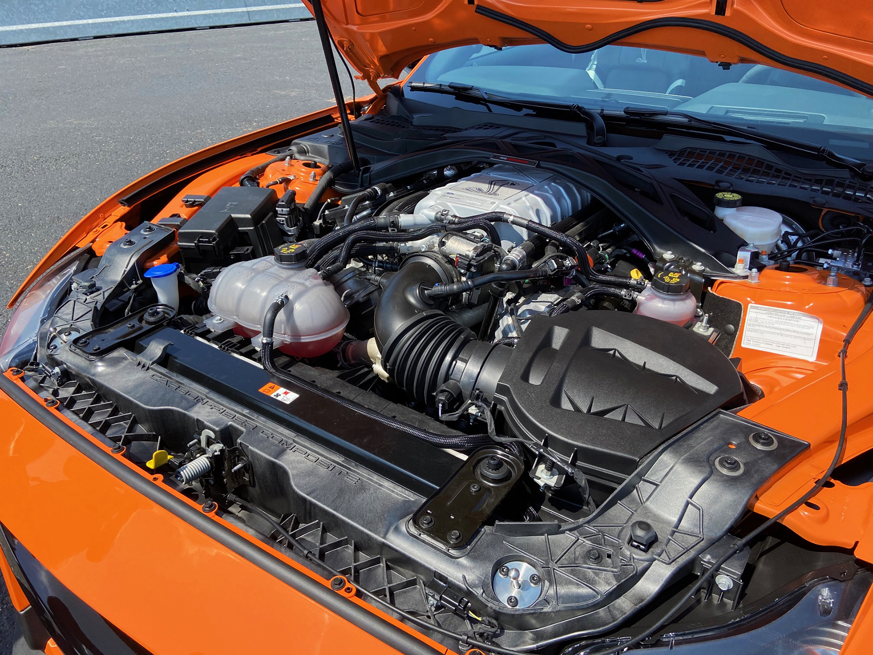 A 5.2-liter supercharged V8 with twin overhead camshafts produces 760 horsepower at 7300 rpm and 625 lb-ft of torque at 5000 rpm. It's an engine that will pull like an overzealous dentist to the 7500-rev redline and deliver a claimed top speed of 180 mph. Where the naturally aspirated 5.2 in the 526-horse Shelby GT350 uses a flat-plane crankshaft, the GT500 engine employs a cross-plane crank that reduces vibration.